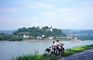 Cyclists pose along the Danube River