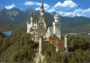 The towers and spires of Neuschwanstein Castle soar above the bike paths of Fuessen in Bavaria