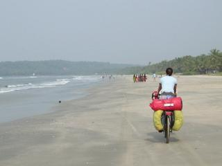 Cycling on the beach in Kerala, India