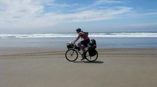 Biking on the beach along the Oregon Coast