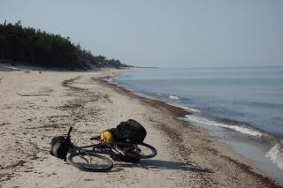 final offroad cycling on the beach of Baltic Sea